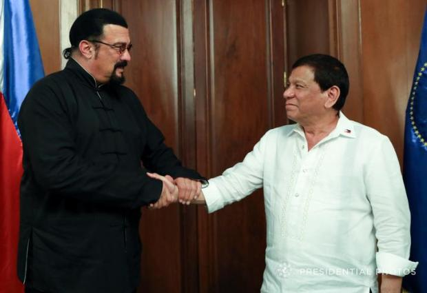 President Rodrigo Duterte greets visiting American actor Steven Seagal (L) during his courtesy call at the Malacanang presidential palace in Manila